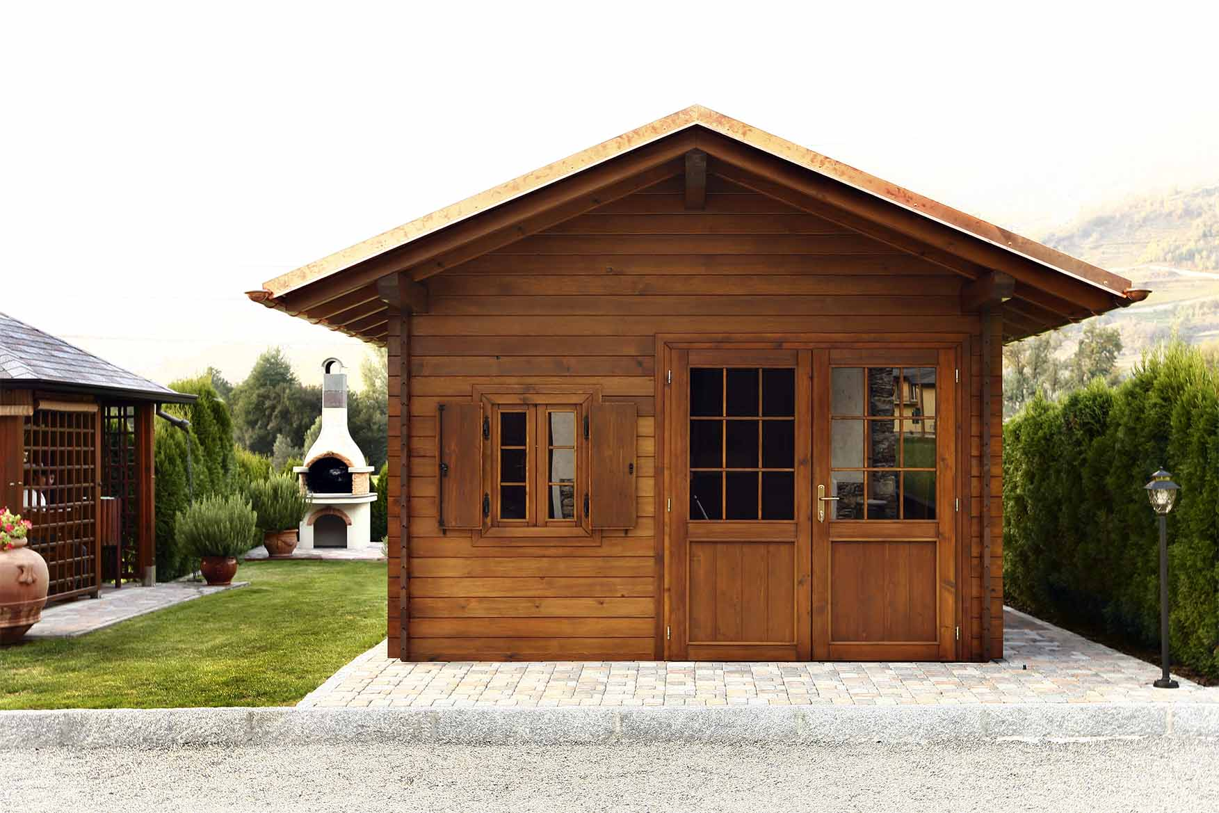 Casetta in legno di pino nordico impregnato in autoclave realizzato da Linea Montanalegno - ILT